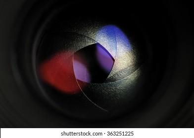 Lens aperture. The diaphragm of a camera lens aperture. Lens front side exposed aperture blades.