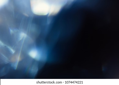 lens flare abstract light glow. optical abstract flash. soft defocused blur. black background