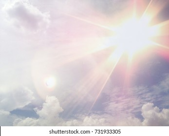 Lens flare in the afternoon on blue sky and white cloud
