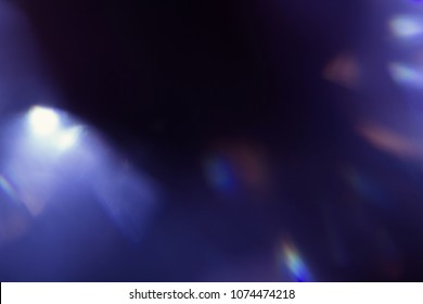 lens flare. colorful abstract blur bokeh light. dark background