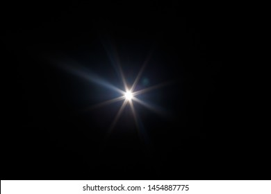 Lens Flare. Light over black background. Easy to add overlay or screen filter over photos. Abstract sun burst with digital lens flare background. Gleams rounded and hexagonal shapes, rainbow halo. - Shutterstock ID 1454887775
