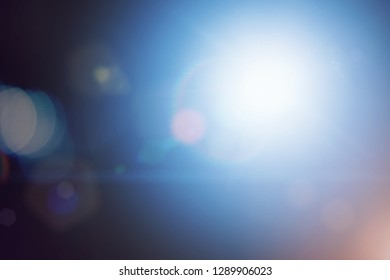 Lens flare on blue blurry background