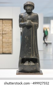 LENS, FRANCE, 2016/08/03. Diorite statue of Gudea, prince of Lagash found in Girsu (today's Tello) in Mesopotamia (today's Iraq). The Louvre Museum in Lens.