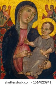 Lens, France. 2019/9/14. Virgin and Child with two Angels. Around 1320. By Deodato Orlandi (active in Tuscany, Italy in 1284-1332). Tempera on panel. Gold background. The Louvre Museum in Lens.