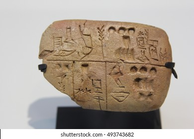 LENS, FRANCE, August 3 2016. Pre-cuneiform writing clay tablet noting food rations. Archives of the Temple of the Sky God. Around 3300 BC. The Louvre Museum,