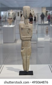 LENS, FRANCE, August 3 2016. Nude marble female idol with arms crossed, possibly a deity. Syros island, Greece. 2700 - 2300 BC. The Louvre museum.