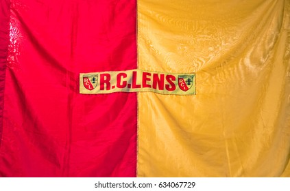 LENS, FRANCE - MAY 20, 2016: Flag of RC Lens in the Louvre-Lens, France. RC Lens,is a French football club based in the northern city of Lens.