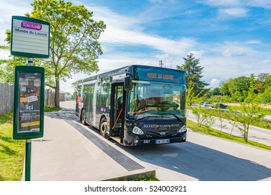 LENS, FRANCE - MAY 20: Public bus at Musee du Louvre bus stop in Lens, France on May 20, 2016. The Louvre-Lens is an art museum located in Lens, Pas-de-Calais, Northern France.
