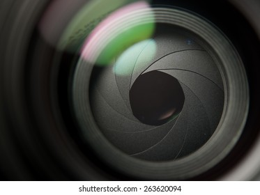 Lens front side exposed aperture blades