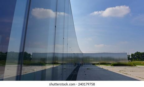 LENS - SEPTEMBER 2014: Exterior glass and modern facade of Louvre-Lens, an art museum on September 15 2014 in Lens, France
