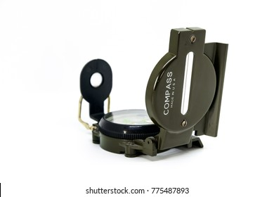 A Lensatic Compass used by military taken in isolation against a white background.
