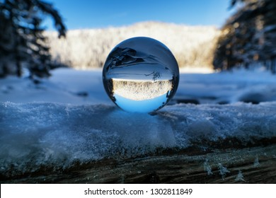 Lensball on frozen lake in winter in the Bohemian forest