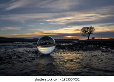 Lensball on Ice. in the back sunset.
