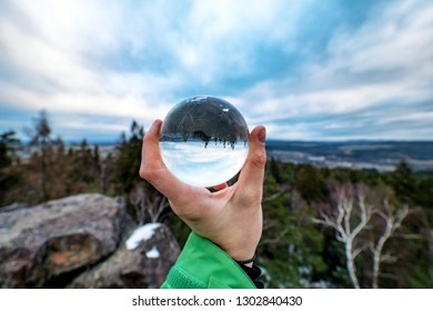 Lensball with a view of the winter landscape
