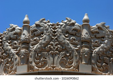 Lensic Theater in downtown Santa Fe, New Mexico has intricate designs on the roofline of the theater.  Dragons with tongues extended decorate exterior.
