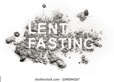 Lent fasting word written in ash, sand or dust as forty days abstinence period time before easter as redemption or penance jesus in desert concept