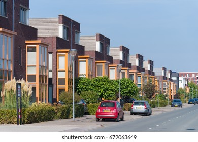 LENT, NETHERLANDS - SEPTEMBER 24, 2016: Modern residential area with identical townhouses