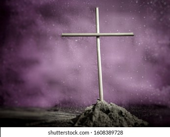 Lent Season,Holy Week and Good Friday concepts - image of wooden cross with ash in blurred purple vintage background