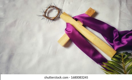 Lent Season,Holy Week and Good Friday concepts - image of wooden cross with purple cloth on it
