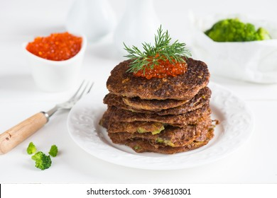 Lenten pancakes with broccoli and protein caviar on a white plate