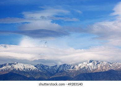 Lenticular clouds float above the San Bernardino Mountains, California, USA