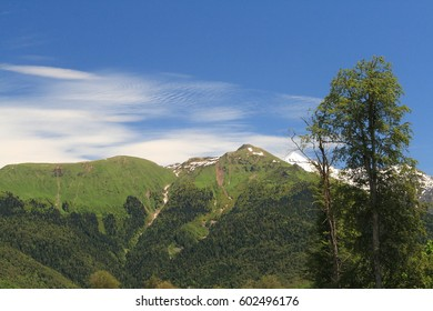 Lenticular clouds hangs over montain village resort.