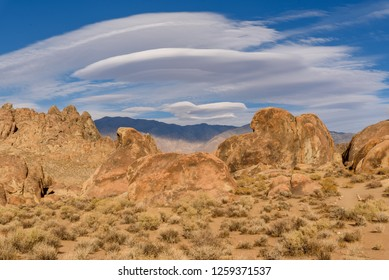Lenticular clouds at Mobius Arch in Alabama Hills, California