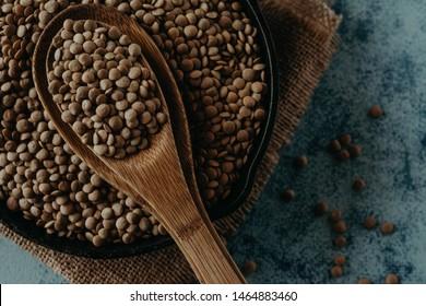 Lentil Beads. Lentil grains in bowl and spoon.