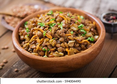 Lentil with carrot and onion in a wooden bowl. Healthy lifestyle. Diet menu