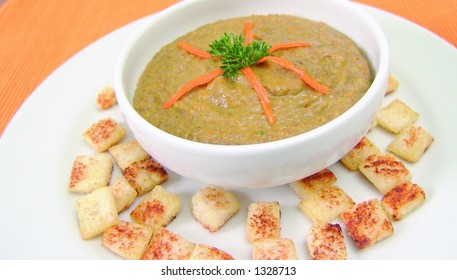 Lentil cream soup with bread croutons and carrot