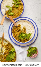 Lentil curry with rice, Indian cuisine, tarka dal, white background. Vegan food. Clean eating concept.