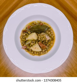 Lentil dish with spanish ham, pork ribs and potatoes.