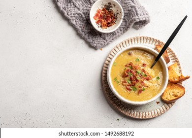 Lentil pea soup garnish with bacon and pork ribs