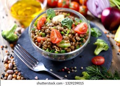 Lentil salad with veggies, healthy food, vegetarian and vegan snack, clean eating, diet, detox