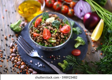 Lentil salad with veggies, healthy food, vegetarian and vegan snack, clean eating, diet, detox. Vegetables and cooking background