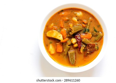 Lentil sambar - south Indian curry with lentil and vegetables isolated on white