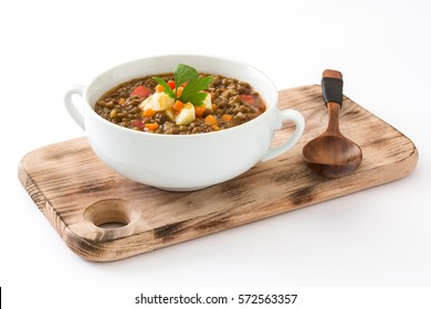 Lentil soup in a bowl, isolated on white background