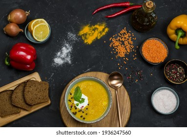 lentil soup. croutons, coconut cream and herbs, spices and ingredients. vegetarian food