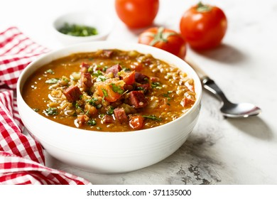 Lentil soup with tomatoes and sausages