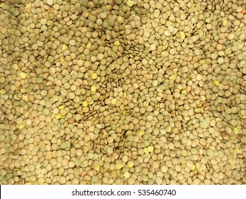 Lentils. Lentils background. Green lentils pattern. Natural organic lentils for healthy food