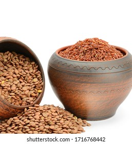 Lentils and brown rice in clay pots isolated on white background. Nutritious vegetarian food.