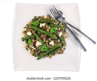 Lentils, freekeh and beans salad with asparagus, green beans, red chili and basil leaves, is a mix of texture, dietary fibre and nutty flavor