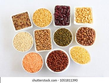Lentils and legumes, different types, including toor, masoor, dal, moong, urad, kulthi, rajma, chana, lobia, split pigeon pea, split chickpea, kidney beans, black-eyed peas, and green gram.