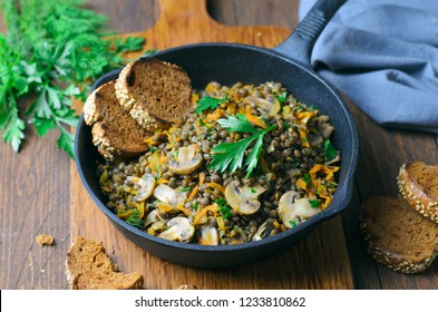 Lentils with Mushrooms, Carrot and Herbs in a Skillet, Healthy Vegetarian Dish
