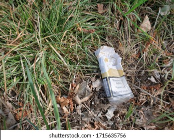Lenzburg, Aargau / Switzerland - April 19, 2020: At the edge of the forest, empty zcragarette box are ruthlessly left, which unfortunately contributes to environmental pollution.