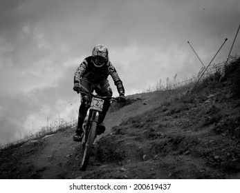 LEOGANG, AUSTRIA - JUNE 13, 2014: Sam Hill of CRC / Nukeproof is seen during training of the UCI Downhill Mountain Bike World Cup in Leogang, Austria.