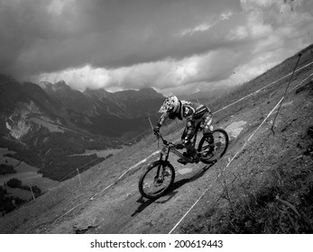 LEOGANG, AUSTRIA - JUNE 13, 2014: Mike Jones of CRC / Nukeproof is seen during training of the UCI Downhill Mountain Bike World Cup in Leogang, Austria.