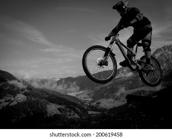 LEOGANG, AUSTRIA - JUNE 13, 2014: Men junior rider Roger Keller is seen during training of the UCI Downhill Mountain Bike World Cup in Leogang, Austria.