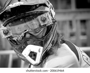 LEOGANG, AUSTRIA - JUNE 13, 2014: Manon Carpenter of Madison Saracen Factory Team is seen after timed training of the UCI Downhill Mountain Bike World Cup in Leogang, Austria.