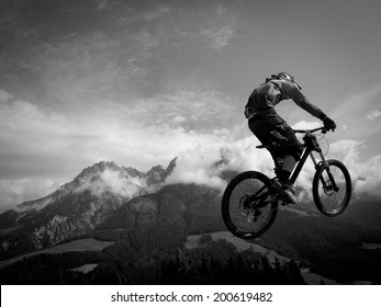 LEOGANG, AUSTRIA - JUNE 13, 2014: Unknown rider is seen during training of the UCI Downhill Mountain Bike World Cup in Leogang, Austria.